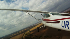 Small plane flies over the fields. View of the cockpit and the wing of aircraft. Stock Footage