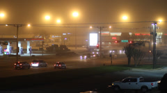 Stoplight Intersection on a Foggy Night Stock Footage
