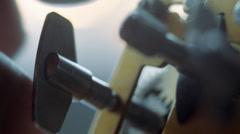 Man winding clockwork mechanism - stock footage