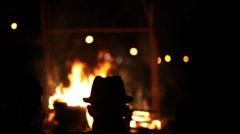 Outdoor bonfire in front of a man with hat. Stock Footage