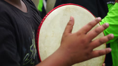 Kids playing Malay tambourine, known as Kompang in wedding ceremony Stock Footage