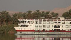 Camera boat on the Nile river, passage of a cruise ship, Egypt Stock Footage
