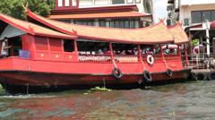 Thailand Bangkok 081 big red painted houseboat on Chao Phraya River Stock Footage