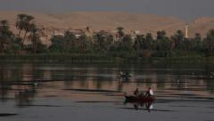 Camera boat Nile river, village and fishermen, Egypt Stock Footage