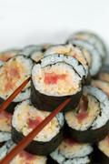 Stock Photo of spicy tuna roll ready to be eaten