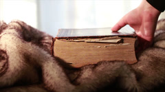 Stock Video Footage of 0385 Ancient Giant Book being Picked up on fur