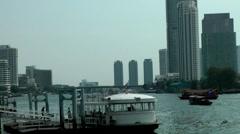 Thailand Bangkok 111 Chao Phraya River, piers, houseboats, modern architecture Stock Footage