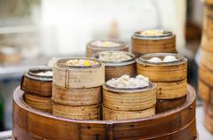 Stacked dim sum steamers at a Hong Kong restaurant Stock Photos