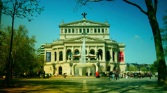 People walk in front of Old Opera in Frankfurt, Germany. Stock Footage