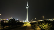 Stock Video Footage of HD video of the stunning Macau Tower and busy freeway at night