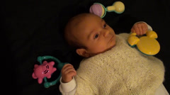 Lonely Baby with toys around Stock Footage