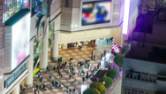 Stock Video Footage of People on the opening space of a shopping mall. HD Tight tilt down shot.