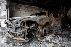 close up photo of a burned out cars - stock photo