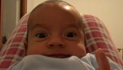 Cute baby looking closely in camera Stock Footage