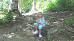 Sad, Thinking Little Girl in Wood, Bored, Thoughtful Child in Forest, Children - stock footage