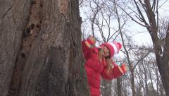 Child, Little Girl Playing Hide and Seek by Tree Trunk in Park, Winter, Children Stock Footage