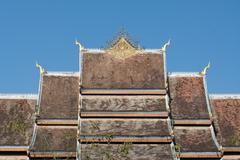 roof of haw pha bang in in luang prabang world heritage, laos - stock photo