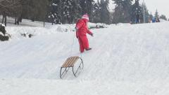 Child Sledding in Snow, View of Little Girl Playing, Sledging in Park in Winter Stock Footage