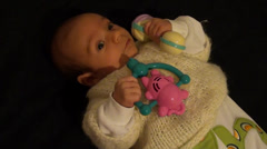 Baby bored with toys Stock Footage