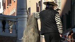 Back of a Gondolier - man takes photo Stock Footage