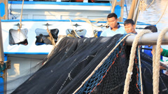Fish net and workers Stock Footage