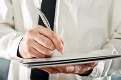 Businessman writing Stock Photos