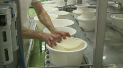 Stock Video Footage of producing traditional cheese in compressed containers