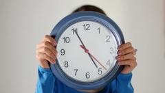 Asian girl hiding behind clock Stock Footage