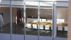 Business team in a boardroom meeting in a large contemporary office building Stock Footage