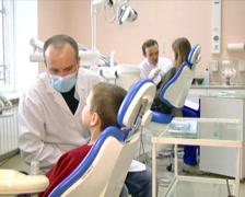 Dentist advises child 1 - stock footage