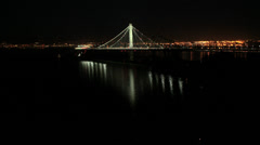 Aerial illuminated low level view New Bay Bridge, San Francisco, USA Stock Footage