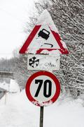 traffic signs and snow - stock photo