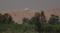 Nile shores with trees and a small blue mosque, Egypt Stock Footage