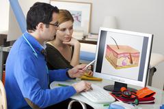 dermatology consultation woman - stock photo