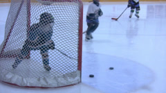 Ice Hockey - Kids Training - Goalkeeper Defending At Group Attack Stock Footage