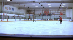 Ice Hockey - Male Training - 01- Few Players Make Shots And Passes - Long View Stock Footage