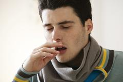 Adolescent sneezing Stock Photos