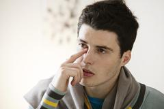 Adolescent with sinusitis Stock Photos