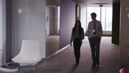 Stock Video Footage of Business team in boardroom meeting in a large modern office building