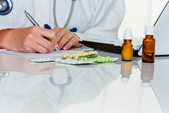 doctor prescribes a drug - stock photo