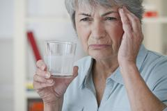 Elderly person taking medication Stock Photos