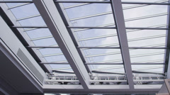 View of the sky and clouds through the glass roof of  office building Stock Footage