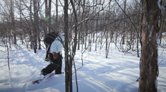 Side View Woman Snowshoeing in nature with a backpaclk (wide angle lens) Stock Footage
