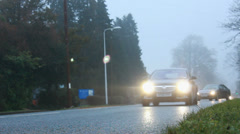 Traffic in heavy fog (lights reflect) dolly Stock Footage