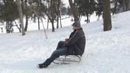 Stock Video Footage of Adult Man Sledding on a Child, Kid Sled in Park, Girl Playing in Snow, Winter