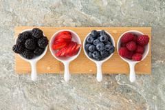 Assorted fresh berries in taster dishes Stock Photos