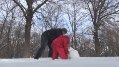 Father, Daughter Making a Snowman, Little Girl Playing in Park, Family in Winter Stock Footage