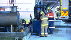Industrial accident hazmat fuel leak at petrol refinery PT18 Stock Footage