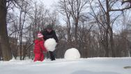 Stock Video Footage of Father, Daughter Making a Snowman, Little Girl Playing in Park, Family in Winter