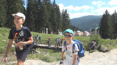 Children Walking on Path in Wood, Tourists Climbing in Mountains, Hiking, Trip - stock footage